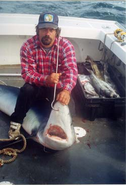 man with prized shark he caught